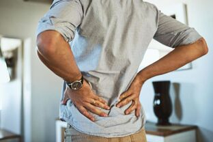 Lower back pain with curvature of the spine